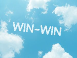 Image of win-win words in cloud against blue sky